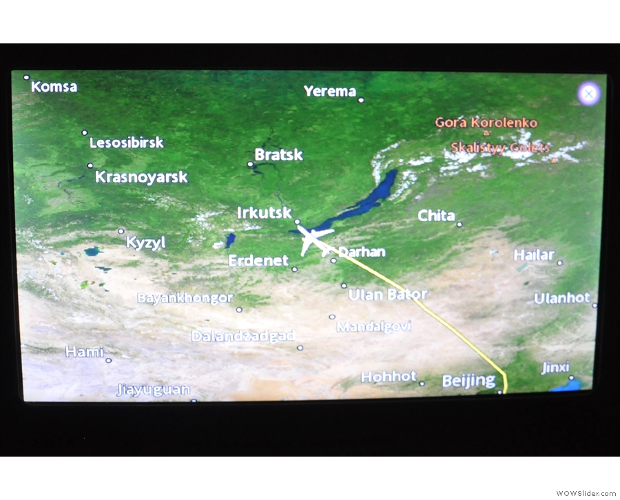 We've been in the air about three hours and are now flying over Russia...