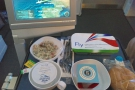 Food arrived somewhere west of the Bay of Biscay, about 90 minutes into the flight.