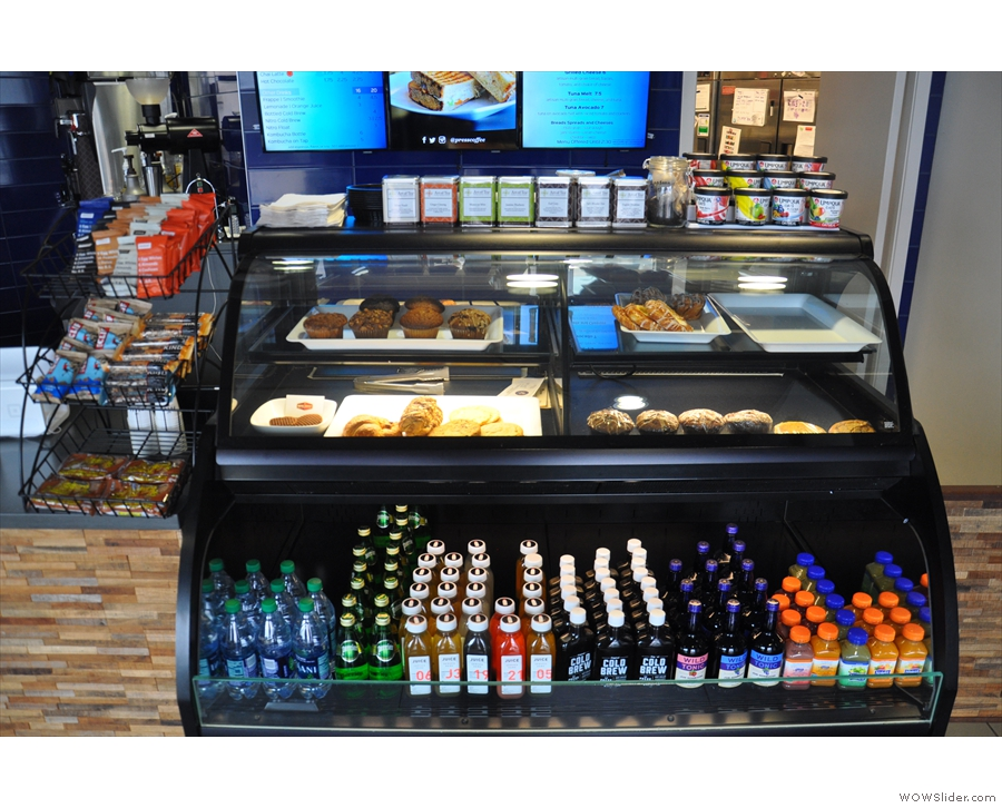 A chiller/display cabinet full of cakes and soft drinks greets you as you enter...