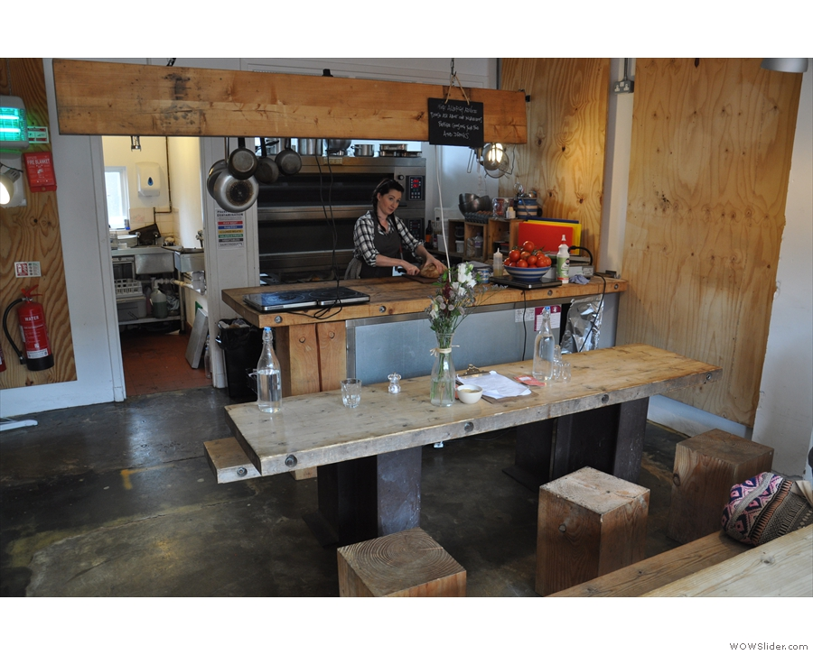 Meanwhile the counter at the back doubles as a kitchen with the ovens behind it.