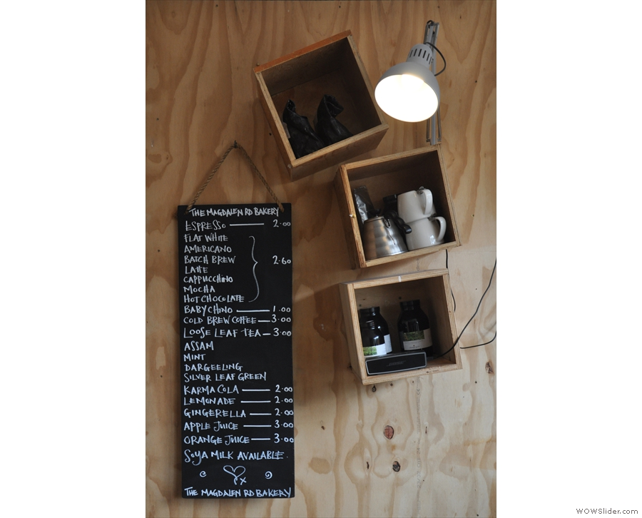 ... while the coffee menu is on the wall at the front next to the espresso machine.