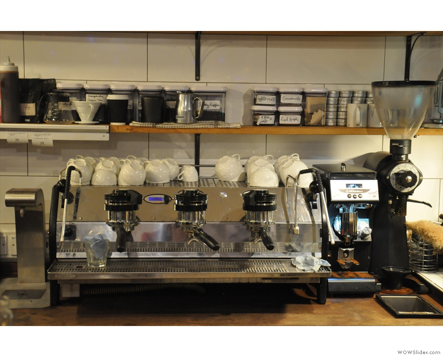 However, my eye was drawn to the three-group La Marzocco Strada behind the counter.