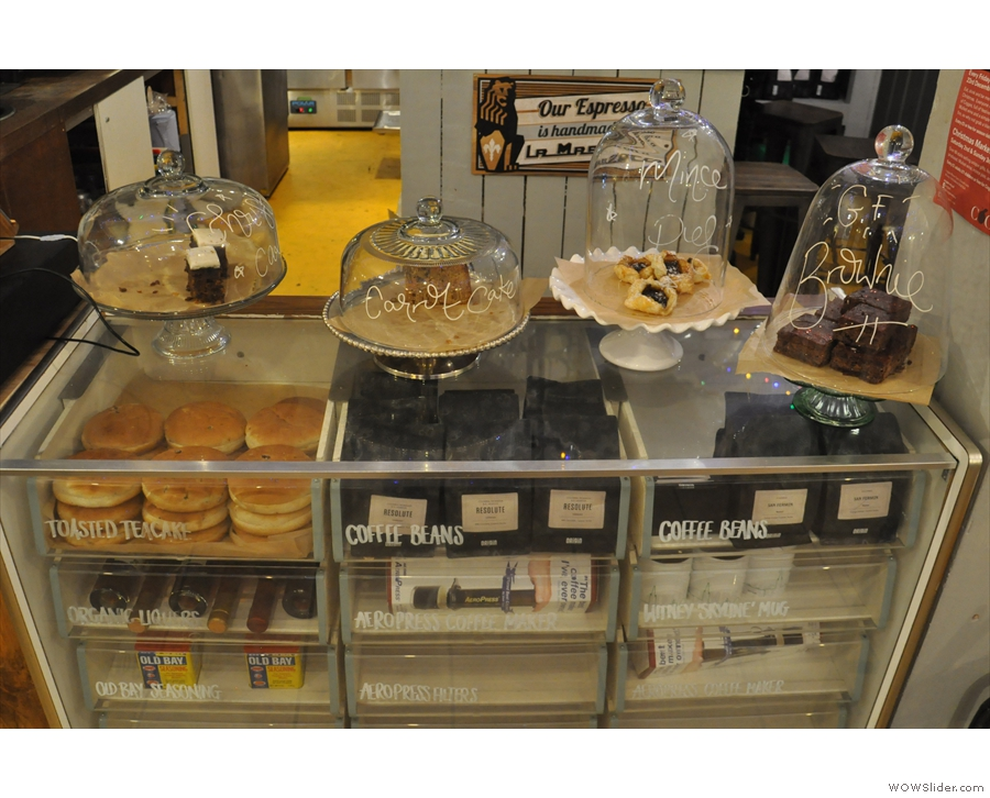 The cakes are all displayed on the right-hand side in this old glass display case...