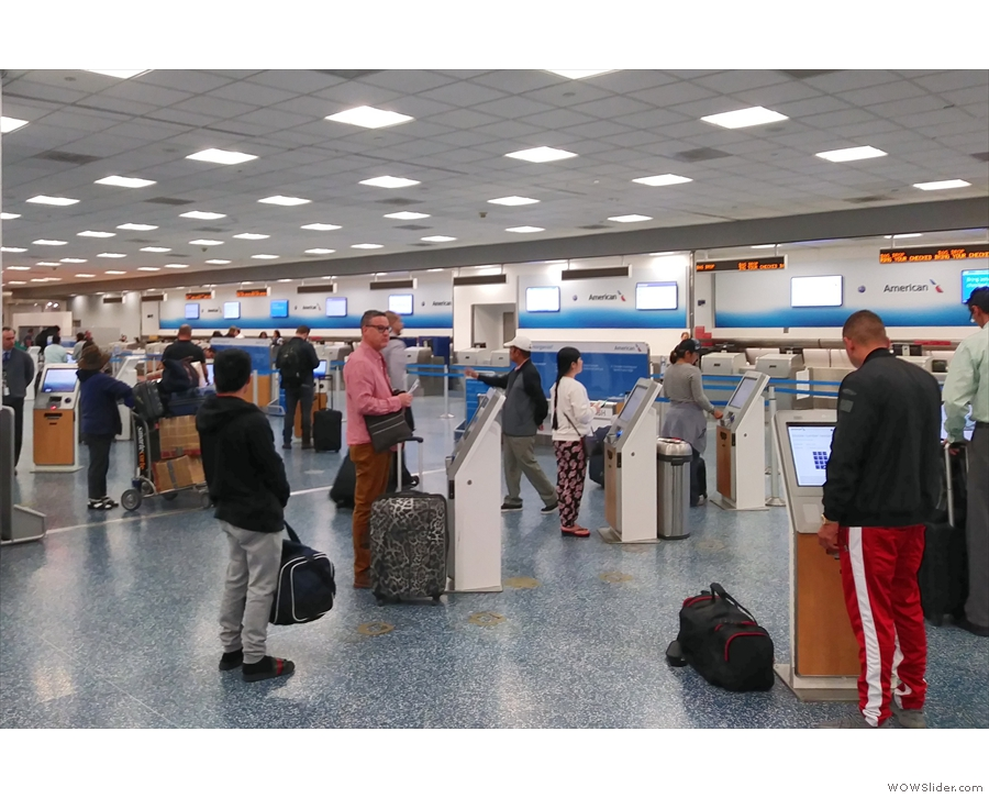 First, find a machine to print your luggage tag, then queue up to hand it in.