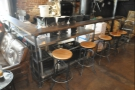 There's a row of five stools down the right-hand side of the roastery area...
