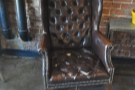 One of the comfortable chairs, much loved, clearly!