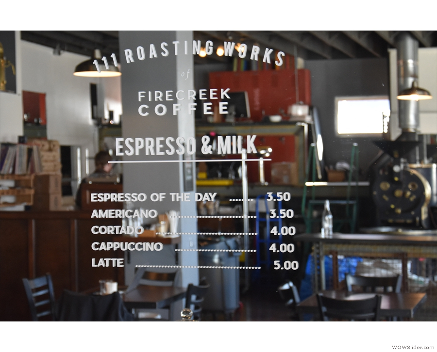 The simple menu is written on the mirror behind the espresso bar.