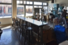 And beyond the tables, the final seating option, the bar overlooking the roastery...