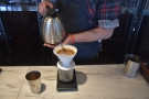Jacob then tops the V60 up in a series of short, controlled pours...