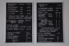 The drinks menu is on the wall behind the counter...