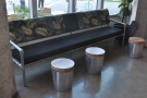 ... followed by the long sofa with small, cylindrical coffee tables.