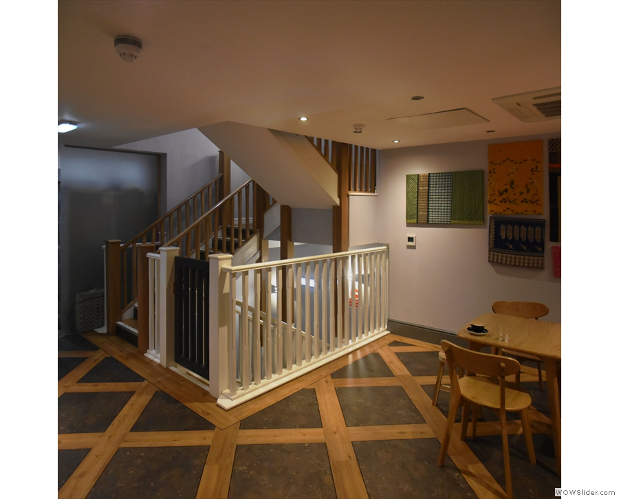 The stairs deposit you in a large, basement-like space with additional seating.