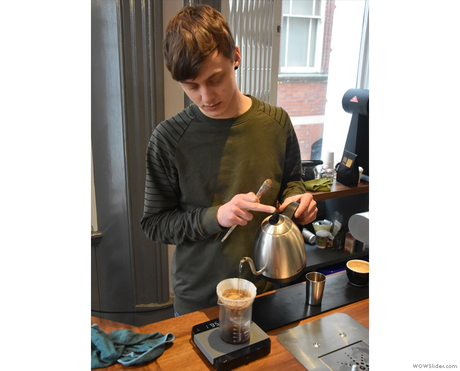 Callum employs a single-pour technique, filling the V60 up to the top...