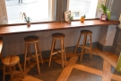 The window-bar with its three high stools in more detail.