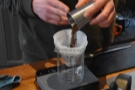 After rinsing the filter paper, Callum grinds the beans then puts them into the V60.