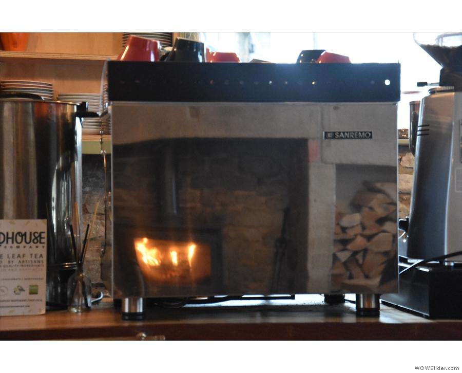 A reflection of the stove in the Sanremo Espresso machine.