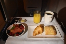 Breakfast was served almost immediately, fresh fruit and warm bread rolls to start with...