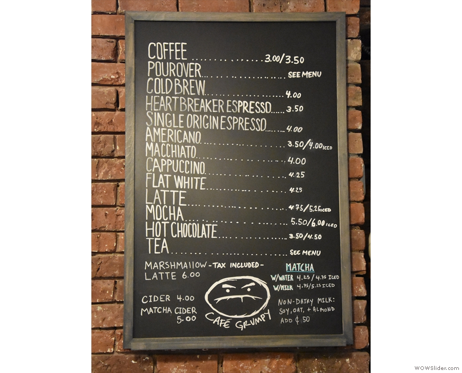 The menu, meanwhile, is on the wall behind the counter...