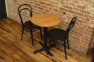 The table, up against the exposed brick wall on the right. I loved the floorboards too.