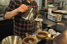 This is Brandon, making me a pour-over on my first visit in 2016. First, rinse the paper.
