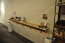 Opposite the espresso machine, another narrow bar acts as the takeaway station.