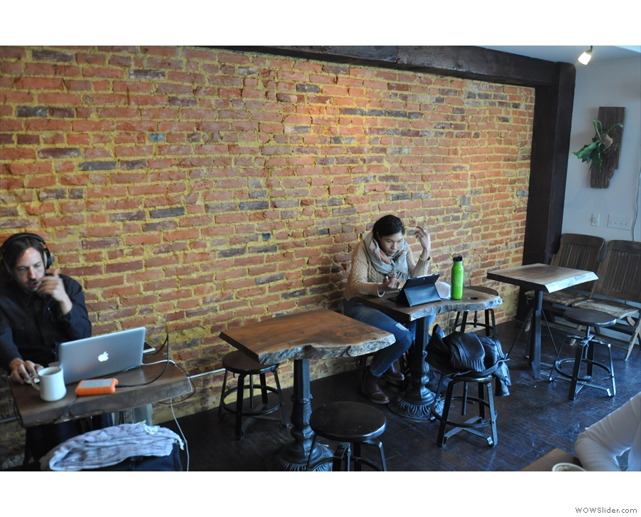 They kicked off a row of four tables along the exposed brick of the right-hand wall.