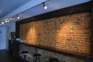 I particularly liked the play of the lights on the exposed brick of the back wall...