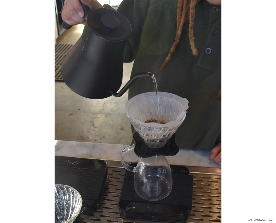 The ground coffee goes in (all 22g of it), and we start with the first pour.