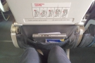 Onboard, and I'm in my exit-row seat. There is, as usual, just enough leg room...