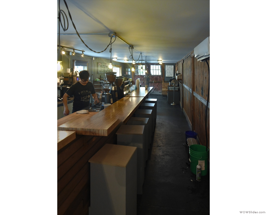 The view of the counter and the counter seating from the back.