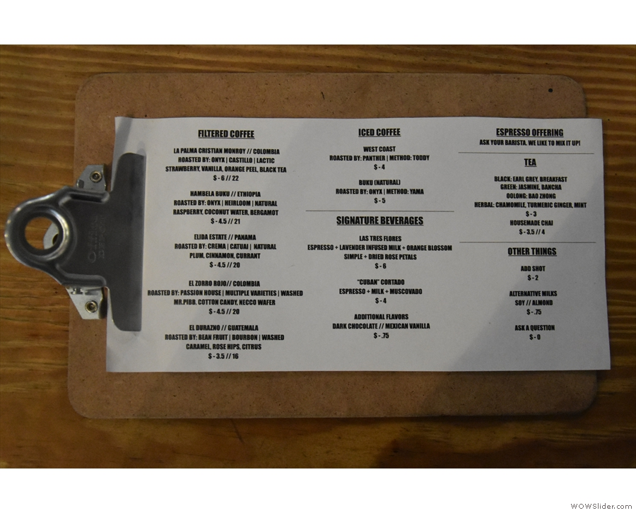 ... while the current pour-over choices are listed on a clipboard on the counter-top.