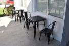 The builk of the seating is out on the patio, with a pair of tables against the east wall...
