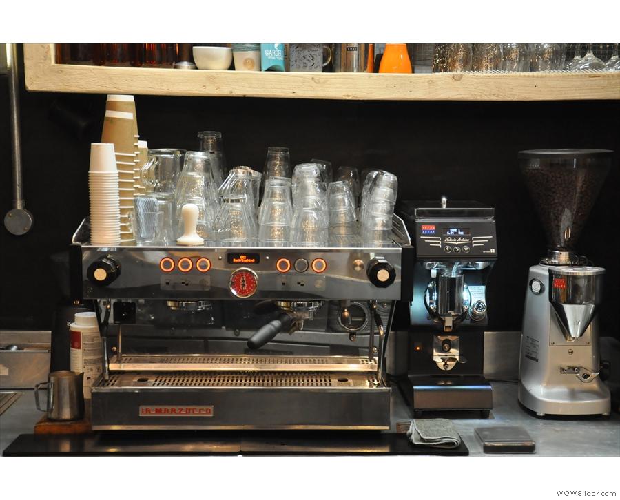 The espresso machine, a La Marzocco Linea, is at the back of the counter.