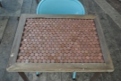 Like all of the two-person tables here, this one is decorated with old 2p coins.