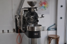 Its dainty little roaster produces all the coffee that you will find in store.