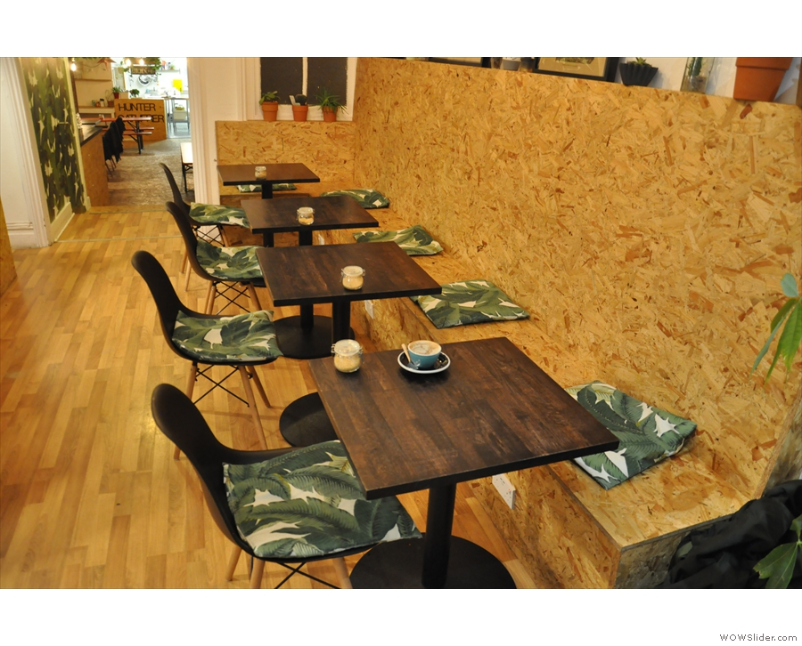 ... with the seating, in the form of a row of four tables, on the right.