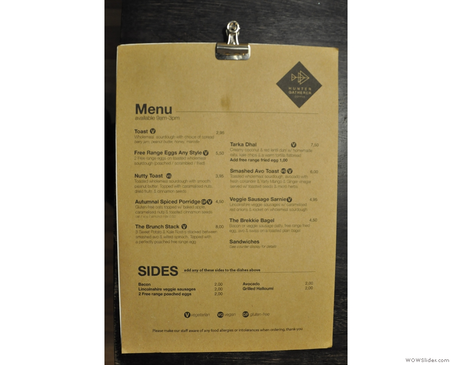 ... with details of the brunch offering. The coffee menu is chalked up above the counter.