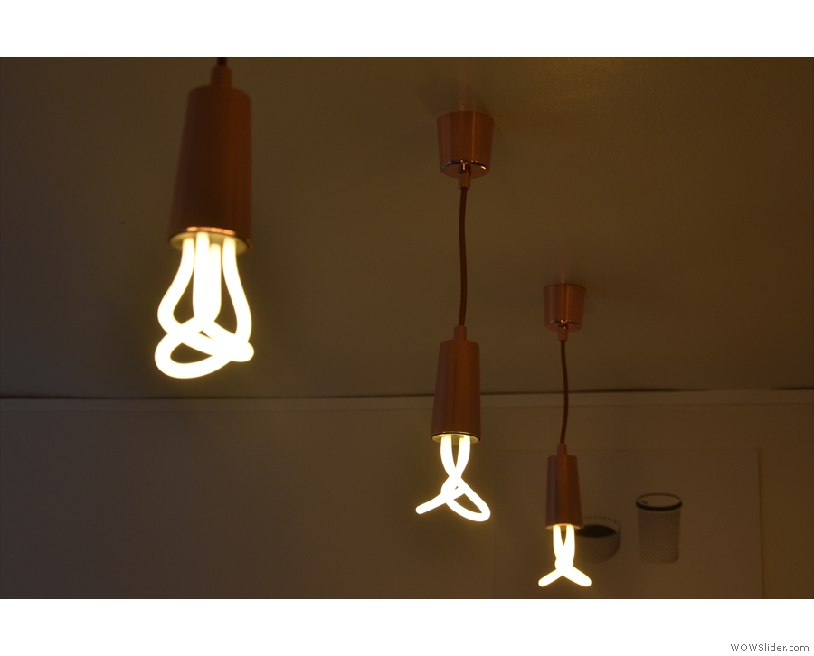 These exposed bulbs hang above the counter...