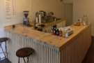 The large counter, made from reclaimed wood, dominates the room.