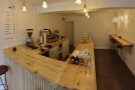 Inside, the coffee shop is as modest as its exterior. This is the view from by the door.