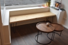 ... where you'll find this bench seat and its split-level coffee table.