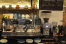 The espresso machine, a two-group Strada, and its grinders are behind the counter.
