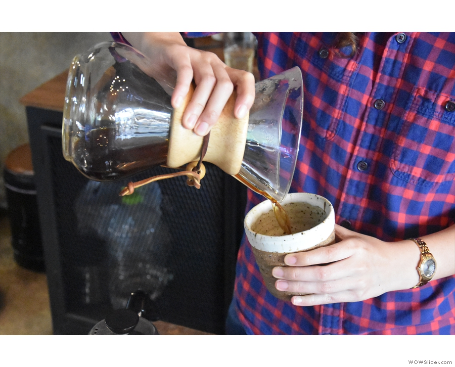 The coffee is poured directly into the mug rather than a carafe.