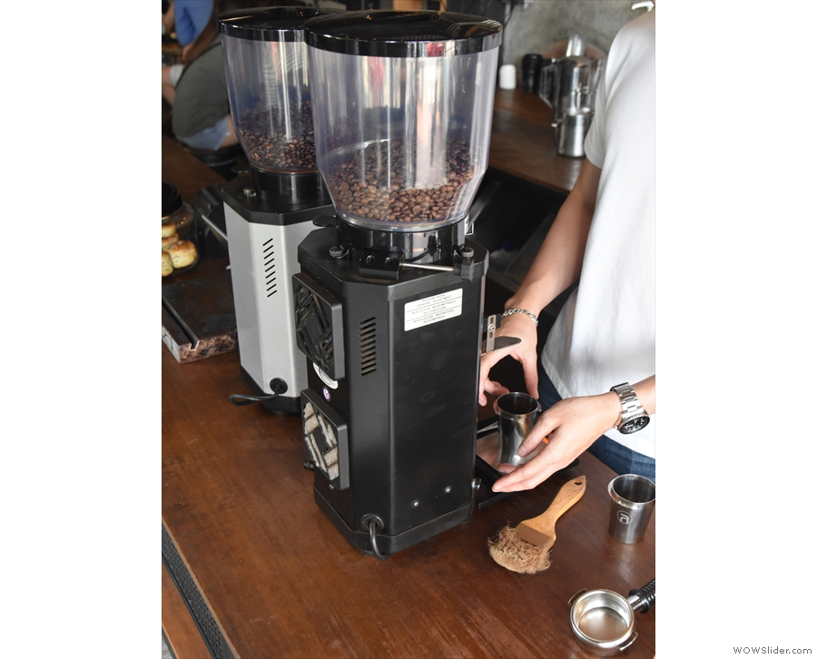Step one, grind the coffee. Most places I know grind into the portafilter, but not here.