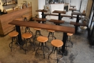 There's a long, communal table here, or three two-person tables.
