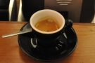 ... this lovely espresso made with the houseblend and served in a classic, black cup.