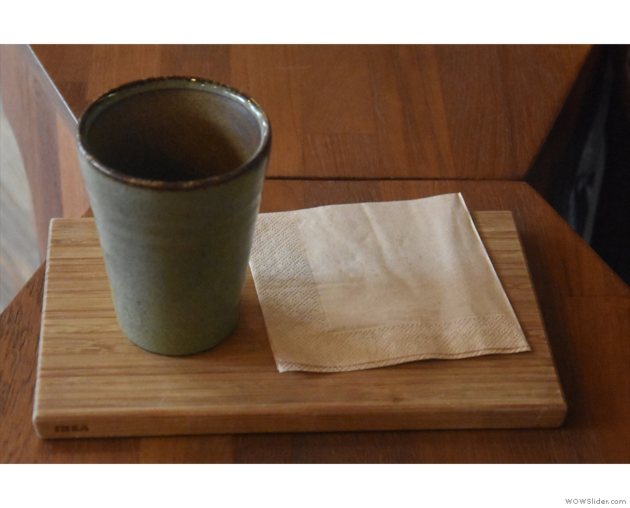 I'll leave you with my coffee, served in a handleless, cylindrical mug on a wooden tray.