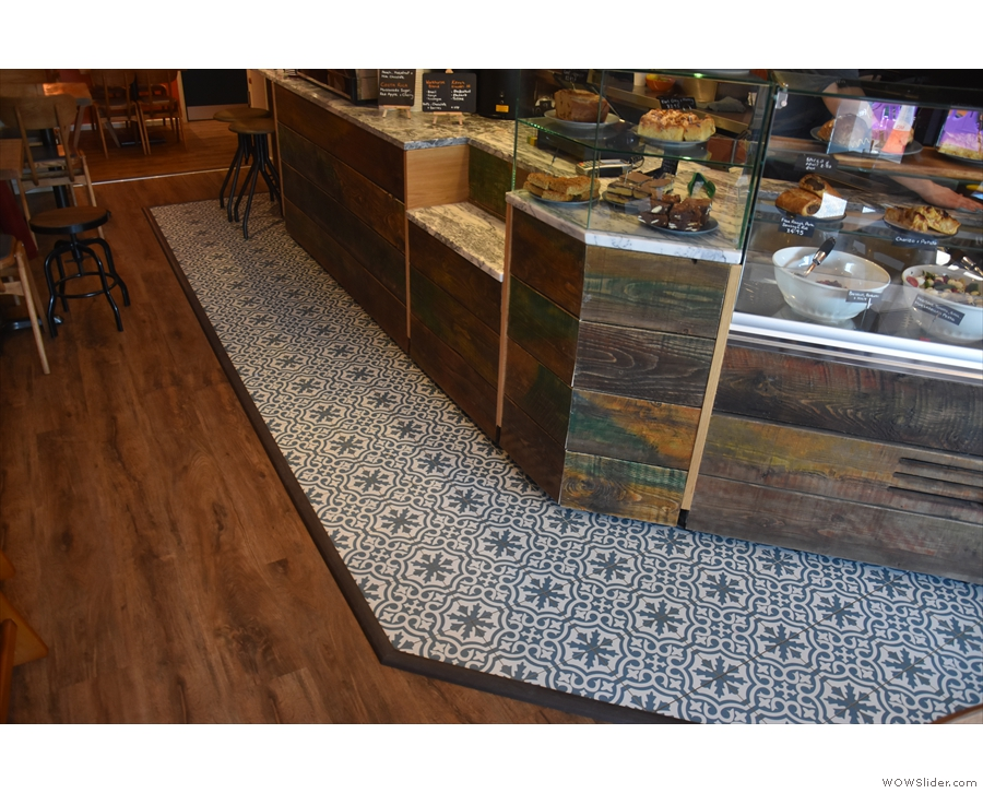 There are many neat features, including wooden floorboards throughout, plus these tiles.