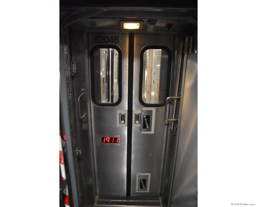 Note the doors between carriages with both push-to-open and kick-to-open buttons.