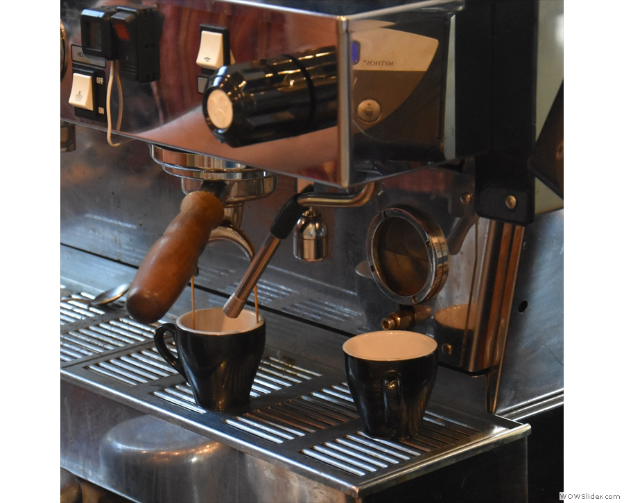 The espresso machine's location makes it easy to watch the coffee extracting.